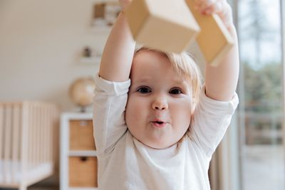 baby-in-white-onesie-holding-wooden-blocks-3933250_opt